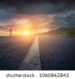 country asphalt road at sunset | Shutterstock . vector #1060862843