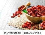 goji fresh fruits seeds in... | Shutterstock . vector #1060864466
