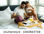 happy romantic young couple... | Shutterstock . vector #1060865768