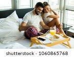 happy romantic young couple... | Shutterstock . vector #1060865768