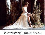 blonde bride in fashion white... | Shutterstock . vector #1060877360
