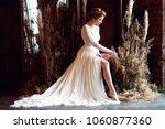 blonde bride in fashion white... | Shutterstock . vector #1060877360
