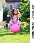 Cute Four Year Girl Bouncing O...