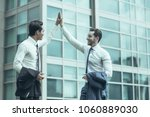 closeup of two smiling business ... | Shutterstock . vector #1060889030
