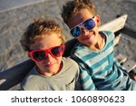 two smiling boys wearing... | Shutterstock . vector #1060890623