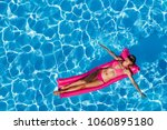 woman floating on air mattress... | Shutterstock . vector #1060895180
