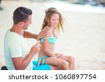 parent applying sun cream to...   Shutterstock . vector #1060897754