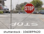 A Stop Sign Attached To Chain...