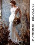 blonde bride in fashion white... | Shutterstock . vector #1060902788