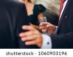 group of elegant people holding ... | Shutterstock . vector #1060903196
