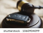 close up of gavel and car key... | Shutterstock . vector #1060904099