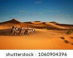 sahara desert camels trekking... | Shutterstock . vector #1060904396