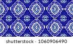 ikat geometric folklore... | Shutterstock .eps vector #1060906490