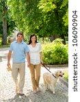 Stock photo couple in love walking labrador dog in park sunny day 106090904