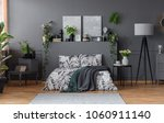 double bed with floral bedding... | Shutterstock . vector #1060911140