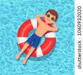 man swims  tanning on life buoy ... | Shutterstock .eps vector #1060932020