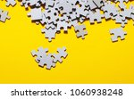puzzles on yellow table ...   Shutterstock . vector #1060938248