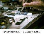 watchmaker man closeup | Shutterstock . vector #1060945253