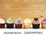 cupcakes with various frosting...   Shutterstock . vector #1060949564