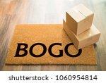bogo welcome mat on wood floor... | Shutterstock . vector #1060954814