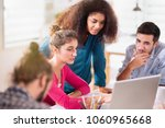 at the office. young colleagues ... | Shutterstock . vector #1060965668