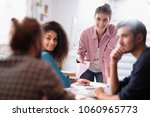 meeting at the startup office.... | Shutterstock . vector #1060965773