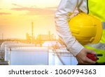 engineers holding safety helmet ... | Shutterstock . vector #1060994363