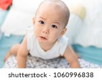 one year old baby crying.sad... | Shutterstock . vector #1060996838