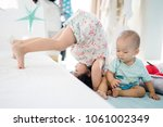 big sister somersault or... | Shutterstock . vector #1061002349