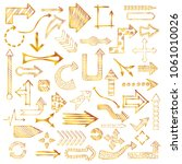 hand drawn sketched gold arrows ... | Shutterstock .eps vector #1061010026