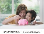 cute asian child and mother... | Shutterstock . vector #1061013623