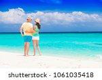 young happy family having fun... | Shutterstock . vector #1061035418