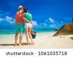 couple in bright clothes on a... | Shutterstock . vector #1061035718