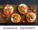 italian bruschetta with chopped ... | Shutterstock . vector #1061042870