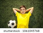 happy teenage boy with a soccer ...   Shutterstock . vector #1061045768