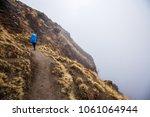 young traveller woman wearing... | Shutterstock . vector #1061064944