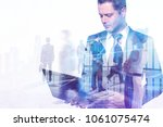 businesspeople on abstract... | Shutterstock . vector #1061075474