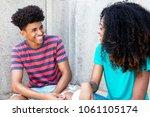african american teens have fun ... | Shutterstock . vector #1061105174