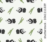 cute sleeping pandas and bamboo.... | Shutterstock .eps vector #1061111339
