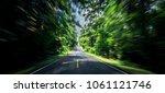 empty asphalt road and speed... | Shutterstock . vector #1061121746