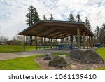 picnic tables under wood... | Shutterstock . vector #1061139410