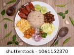 thai fried rice with shrimp... | Shutterstock . vector #1061152370