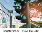 traffic light green. street... | Shutterstock . vector #1061153030