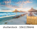 beach with chairs and umbrella... | Shutterstock . vector #1061158646