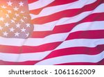 usa flag blown by the wind. | Shutterstock . vector #1061162009