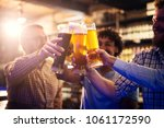 focus view of hands and beer... | Shutterstock . vector #1061172590