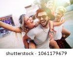group of friends having fun... | Shutterstock . vector #1061179679