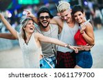 group of friends having fun... | Shutterstock . vector #1061179700