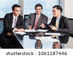 three asian businessmen in... | Shutterstock . vector #1061187446