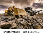 excavator and machinery in an... | Shutterstock . vector #1061188913